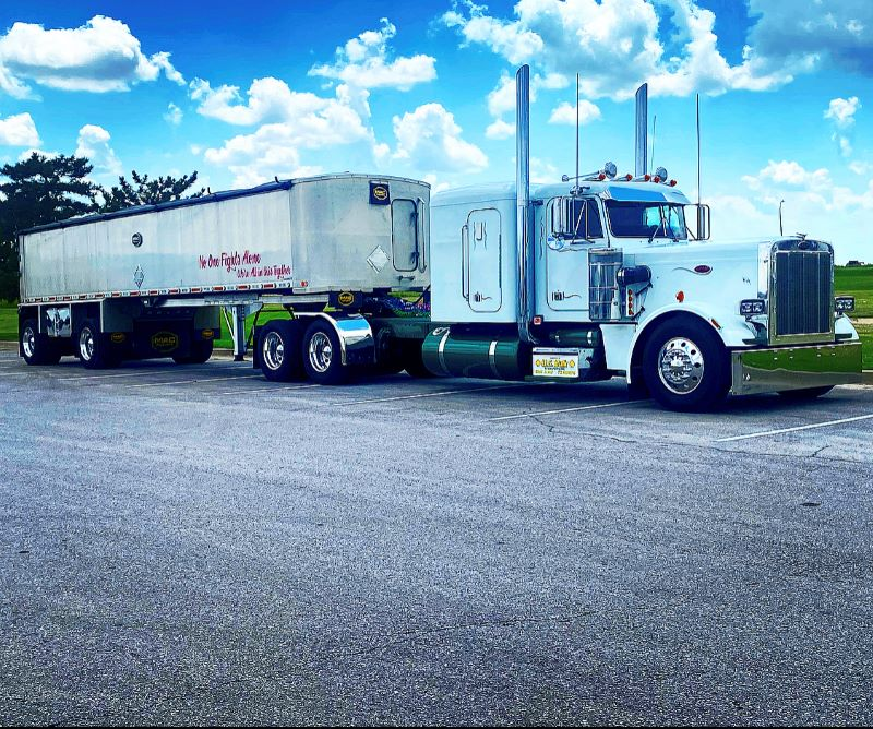 U.S. Bulk end dump tractor trailer in parking lot