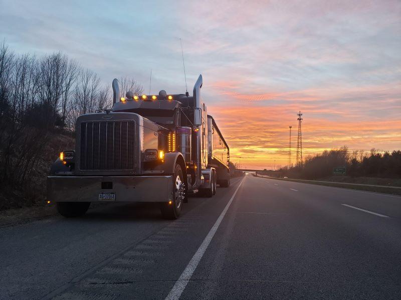 dry bulk end dump trailer driving through southwest